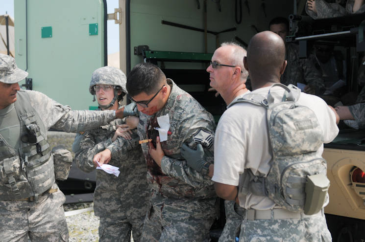 Members of the 104th Area Support Medical Company conduct routine and emergent medical care during training missions on Warfield Air National Guard Base in Middle River, Md., Aug. 1, 2015. The ASMC trains to establish a fully functional Role II Medical Treatment Facility as part of the unit's annual training. (Photo by Army National Guard Spc. Allen Griffith)