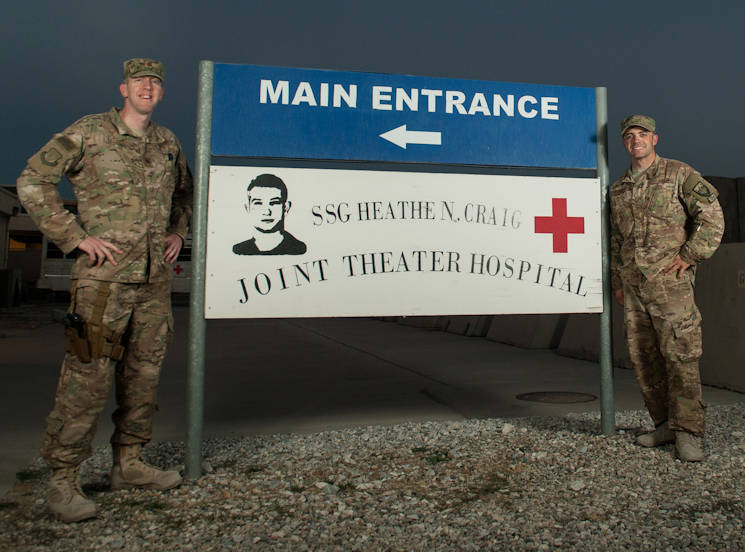 U.S. Air Force Maj. Thomas Naughton (left) and Tech. Sgt. Scott Hatch (right) both assigned to the 455th Expeditionary Medical Group, stand by the sign to at the main entrance to Craig Joint Theater Hospital at Bagram Air Field, Afghanistan, Sept. 24, 2015. (U.S. Air Force photo by Tech. Sgt. Joseph Swafford)