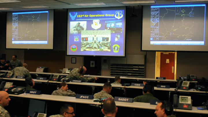 Airmen of the New York Air National Guard's 152nd Air Operations Group man their stations during Virtual Flag, a computer wargame held Feb. 18-26, 2015 from Hancock Field Air National Guard Base. The computer hookup allowed the air war planners of the 152nd to interact with other Air Force units around the country and in Europe. (U.S. Air National Guard photo by Master Sgt. Eric Miller)