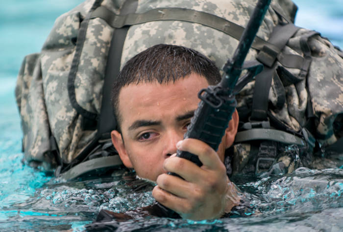A U.S. Army Reserve combat engineer, assigned to 416th Theater Engineer Command, conducts Combat Water Survival Training, part of Sapper Leader Course prerequisite training, at Fort Hunter Liggett, CA on July 17, 2015. U.S. Army photo by Master Sgt. Michel Sauret)