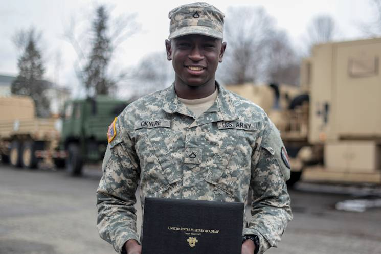 New Jersey Army National Guard Pfc. Nathaniel Okyere-Bour stands at the Morristown Armory with his acceptance letter from the U.S. Military Academy at West Point, N.Y., March 27, 2015. Okyere-Bour is a wheeled-vehicle maintenance specialist from the 250th Brigade Support Battalion, and is currently a student at Rutgers University. He was one of 25 Army National Guard Soldiers to be accepted into West Point this year. (U.S. Air National Guard photo by Tech. Sgt. Matt Hecht)