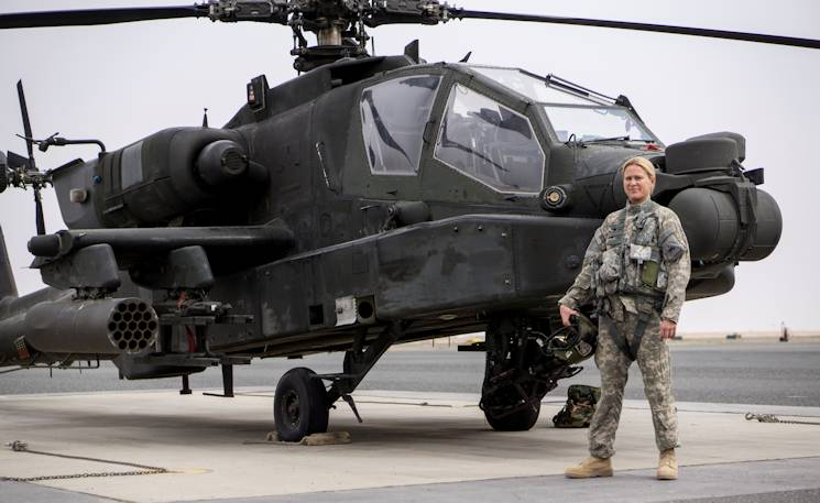 March 26, 2015 - Chief Warrant Officer 2 Rebekah M. Wottge, B Co., 4-501st Attack Reconnaissance Battalion Apache helicopter pilot, is one of the few female Apache pilots deployed with the 34th Combat Aviation Brigade. She has flown over 100 hours in Kuwait so far. (Minnesota Army National Guard photo by Spc. Jess Nemec)