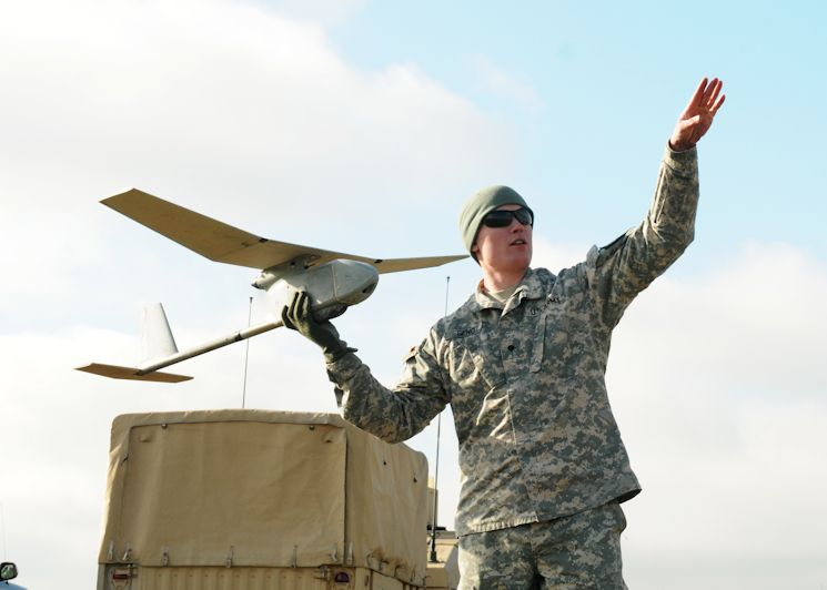 "Spc. Thomas Geno, infantryman, Company C, 1st Battalion, 17th Infantry Regiment, 2nd Stryker Brigade Combat Team, 2nd Infantry Division, prepares to throw an RQ-11 Raven Unmanned Aerial Vehicle on Joint Base Lewis-McChord, Wash., Jan. 29, 2015. Geno, a native of St. Louis, was one of 14 ""Lancer"" Soldiers to qualify during the two-week Raven Certification Course. (U.S. Army photo by Sgt. 1st Class Andrew Porch, 28th Public Affairs Detachment)"