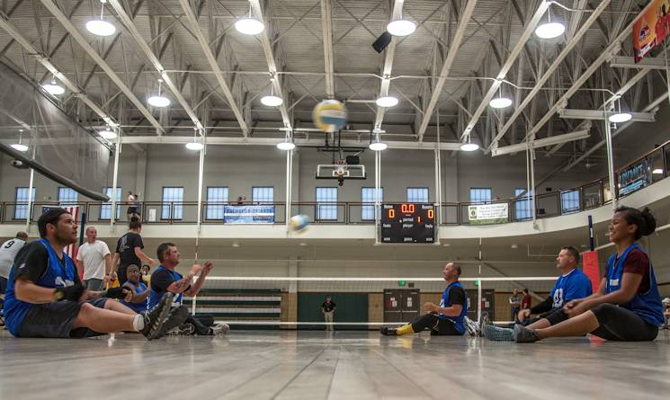 Wounded warrior athletes practice before a game of seated volleyball during the Army Trial, Fort Bliss Texas, April 1, 2015. The Army Trials showcase the resilient spirit of wounded, ill and injured Soldiers and veterans. Participants in Army Trials include athletes with spinal cord injuries, traumatic brain injuries, visual impairments, serious illnesses and amputations. The results of the games help determine which Army athletes compete on the Department of Defense level Army competition team. (U.S. Army photo by Sgt. Marcus Fichtl)