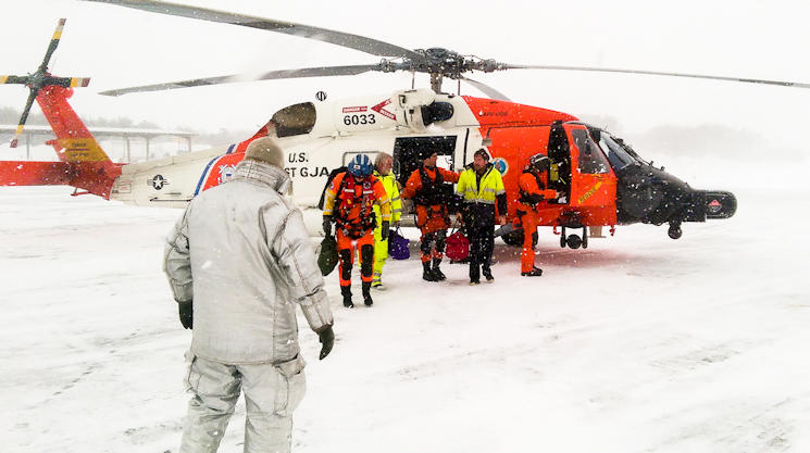 A Coast Guard Air Station Cape Cod helicopter crew returns from rescuing a father and son from a sailboat about 150 miles south of Nantucket, Mass., Feb. 15, 2015. After navigating through low visibility and near hurricane force winds, the crew safely hoisted the men and returned to Air Station Cape Cod. (U.S. Coast Guard photo contributed by Coast Guard Air Station Cape Cod.)