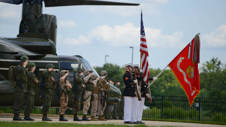 A Marine Corps color guard presents the colors during the playing of the Star Spangled Banner August 1, 2015, during the CH-46 Last Flight Retirement Ceremony at the Smithsonian Institution National Air and Space Museum Steven F. Udvar-Hazy Center in Chantilly, Virginia. The CH-46's main mission has been to provide combat support, however, the aircraft also flew resupply missions, medical evacuations and tactical recovery of aircraft and personnel. (U.S. Marine Corps photo by Cpl. Cuong Le)