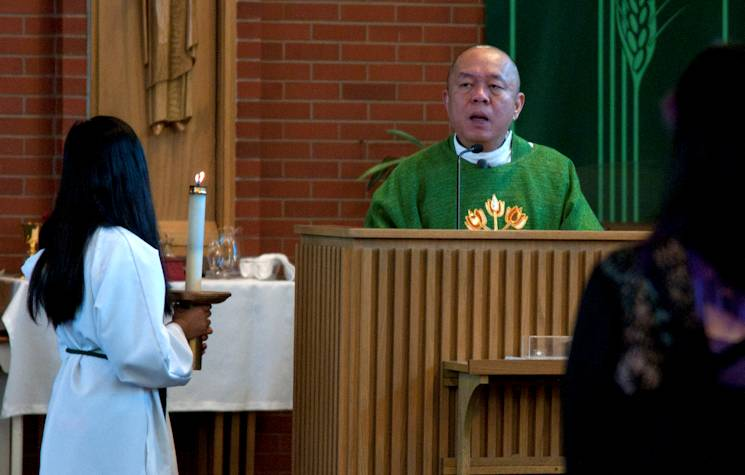 Capt. James Calledo, chaplain, 90th Missile Wing Catholic priest, gives a sermon during a Catholic Mass Jan. 25, 2014, at the High Plains Chapel on F.E. Warren Air Force Base, Wyo. Mass is held daily at 11:30 a.m. and Sundays at 9:15 a.m. (U.S. Air Force photo by Airman 1st Class Malcolm Mayfield)