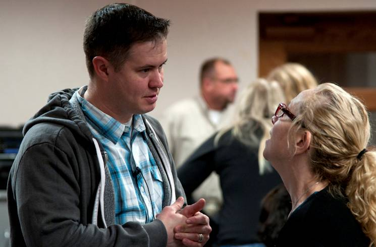 Capt. Robert Tilley, 90th Missile Wing Protestant chaplain, talks with a congregation member after the Protestant Contemporary service Jan. 25, 2014, in the Chapel Activities Center on F.E. Warren Air Force Base, Wyo. A portion of what chaplains do involves counseling service members and their families. (U.S. Air Force photo by Airman 1st Class Malcolm Mayfield)