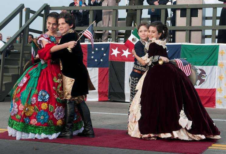 The International Bridge Ceremony at the Lincoln-Juarez bridge in Laredo, Texas, begins with two children from the United States and two children from Mexico abrazando, or embracing, at the center of the bridge. The ceremony commemorates the bonds between the United States and Mexico and features a series of abrazos, or embraces, between representatives of the two countries in the center of the bridge. (U.S. Army National Guard photo by Sgt. Michael Vanpool, 36th Infantry Division Public Affairs)