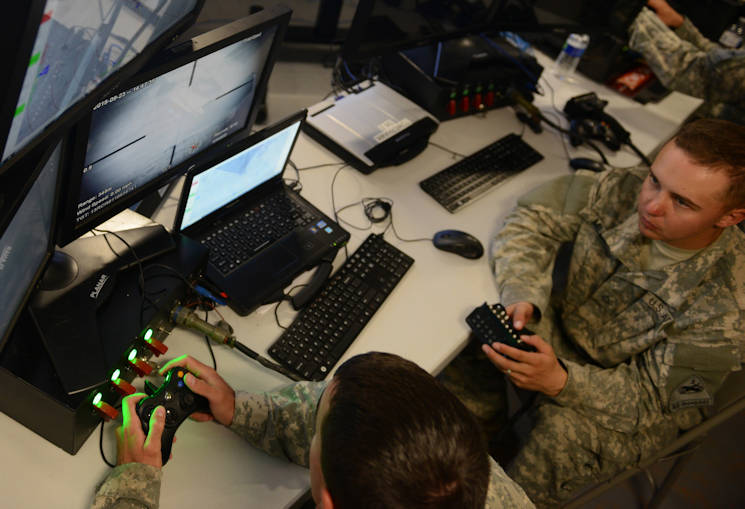 Cyber warriors defend the network at the tactical operations center for 2nd Armored Brigade Combat Team, 1st Armored Division, on Fort Bliss, Texas, during Network Integration Evaluation 16.1, which ran from Sept. 25 to Oct. 8, 2015. (U.S. Army photo by David Vergun)
