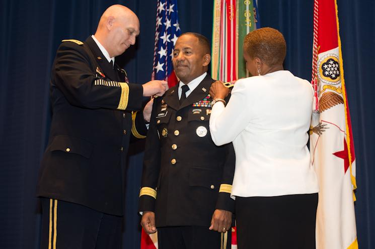 Army Chief of Staff Gen. Ray Odierno and Monique Ferrell pin three-star rank on Army Lt. Gen. Robert S. Ferrell during a Jan. 24, 2014, promotion ceremony at Fort Lesley J. McNair in Washington, D.C. (U.S. Army photo by Staff Sgt. Steve Cortez)