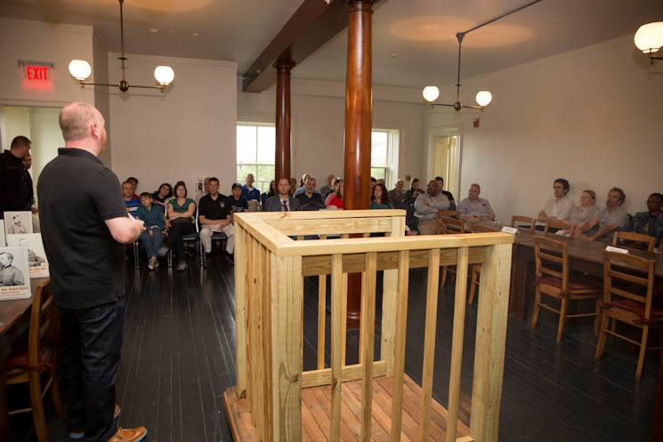 Guests visiting Grant Hall on the Fort McNair portion of Joint Base Myer-Henderson Hall fill the reconstructed courtroom where the Lincoln conspirators' military tribunal took place, during an open house May 9, 2015 on the 150th anniversary of the trial's start. (Joint Base Myer-Henderson Hall PAO photo by Damien Salas)
