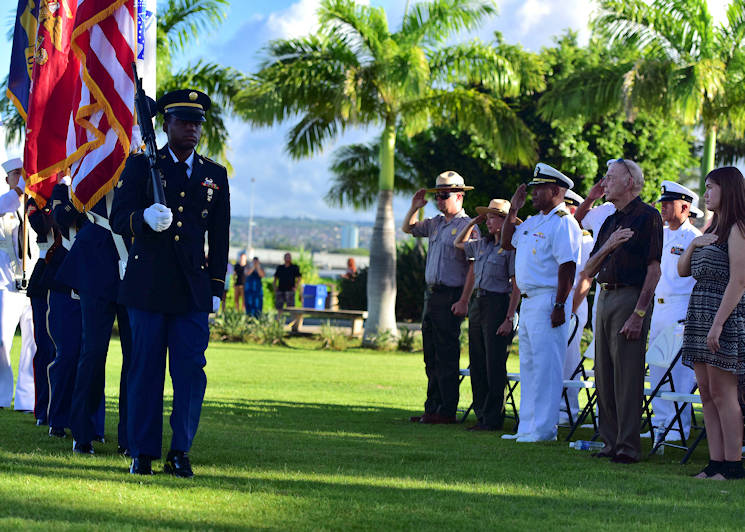 Capt. Stanley Keeve, commander of Joint Base Pearl Harbor-Hickam, and retired Navy Capt. Gerald L. Coffee, a former Vietnam War prisoner of war, salute as members of the Joint-Service color guard pass by during a Pearl Harbor Colors ceremony, held Thursday at the Pearl Harbor Visitor's Center. The special ceremony paid homage to the service and sacrifices of those who were missing in action (MIA) and prisoners of war (POW). The Pearl Harbor Colors ceremony highlights a different theme of military heritage every month. (U.S. Air Force photo by Senior Airman Christopher Stoltz)