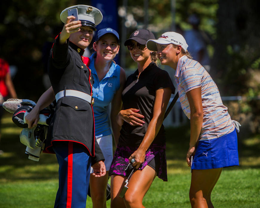 (Left to right) Marine Corps Sergeant Justin Tellar takes a selfie with professional golfers Katherine Perry, Alexandria Jacobsen and Kaitlin Coons following their completion of the W. B. Mason Championship at the Thorney Lea Golf Club, Aug. 16, 2015. Marines of Recruiting Station Portsmouth were invited to tour the course and view the championship, where the golfers play for a spot in the Ladies Professional Golf Association Tour. Tellar is a canvassing recruiter with Recruiting Substation Brockton, Massachusetts. Perry is from Cary, North Carolina, Jacobsen is from Palm City, Florida, and COons is from Wilbraham, Mass. (U.S. Marine Corps photo by Sgt. Terry Brady)