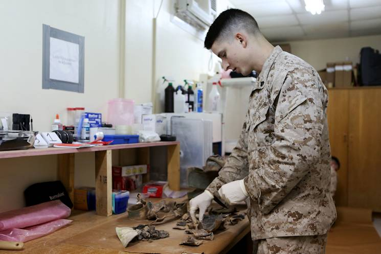 Marine Cpl. Blake A. Wintch with the Exploitation Analysis Center, Special Purpose Marine Air Ground Task Force-Crisis Response-Central Command, organizes exploded ordinance Dec. 28, 2014. The center processes thousands of pieces from a variety of devices, adding another facet to the many capabilities of the SPMAGTF. (U.S. Marine Corps photo by Cpl. Tony Simmons)