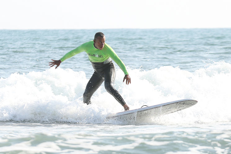 Marine Corps Master Sgt. Hugo L. Gonzalez surfs with Operation Amped at San Onofre Beach, Calif., August 21, 2015. Operation Amped, an annual surfing event open to Wounded Warriors and their families, aims to share the healing potential of surfing with seriously ill, injured, or disabled U.S. military veterans and their families. (U.S. Marine Corps photo by Cpl. Asia J. Sorenson)