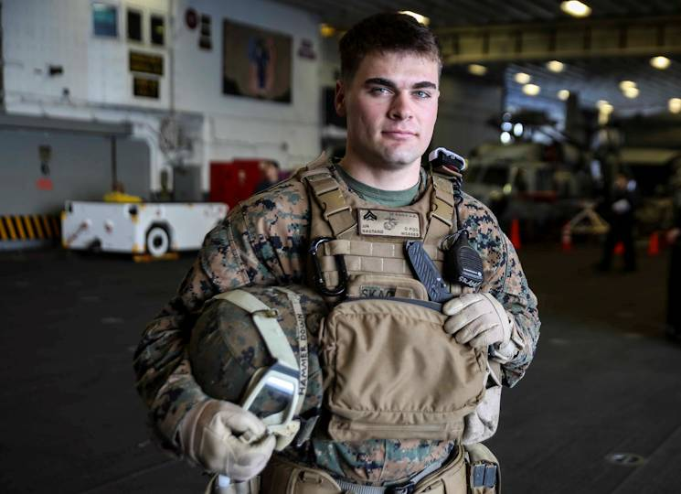 U.S. Marine Corps Cpl. Jeremiah Skaggs stands in the hangar bay of the USS Bonhomme Richard (LHD 6) at sea, March 16, 2015. Skaggs, from Stockton, California, has trained in multiple environments including Bridgeport, California, Twentynine Palms, California, Okinawa, Japan, and now aboard the USS Bonhomme Richard. Cpl. Skaggs is a squad leader with Weapons Co., Battalion Landing Team 2nd Battalion, 4th Marines, 31st Marine Expeditionary Unit and is currently participating in the MEU's annually-scheduled Spring Patrol of the Asia-Pacific region. (U.S. Marine Corps photo by Lance Cpl. Ryan C. Mains)