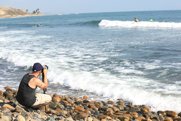 "Marine Corps Staff Sgt. Matthew L. Slade photographs Operation Amped surfers on San Onofre Beach, Calif., August 21. 2015. Slade is a wounded warrior and student of Wounded Warrior Battalion West's ""fStop"" photography class. The class supports wounded warriors' recovery and transition through creative self-expression using the art of digital photography. (U.S. Marine Corps photo by Cpl. Asia J. Sorenson)"
