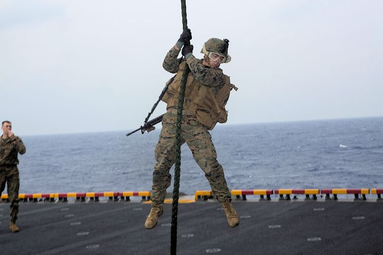 U.S. Marine Corps Lance Cpl. Nicholas Santos, mortarman, Battalion Landing Team 2nd Battalion, 4th Marines, 31st Marine Expeditionary Unit (MEU), fast ropes off an MV-22B Osprey belonging to Marine Medium Tiltrotor Squadron 262 (Reinforced), 31st MEU, on the USS Bonhomme Richard (LHD 6), at sea, Feb. 18, 2015. The Marines of the 31st MEU are currently conducting their annual Spring Patrol of the Asia-Pacific region. (U.S. Marine Corps photo by Lance Cpl. Richard Currier)