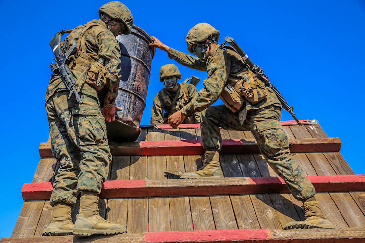 Recruits of Charlie Company, 1st Recruit Training Battalion, carry a barrel over a wall during the 12 Stalls event of the Crucible at Edson Range, Weapons and Field Training Battalion, Marine Corps Base Camp Pendleton, CA Sept. 23, 2015. For every task given, recruits were instructed to avoid the areas of the obstacles painted red. If the recruits or any part of their equipment touched the red areas, the squad was required to start the challenge over. Today, all males recruited from west of the Mississippi are trained at MCRD San Diego. The depot is responsible for training more than 16,000 recruits annually. (U.S. Marine Corps photo by Lance Cpl. Angelica Annastas)