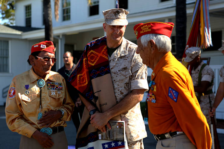 "Marine Corps Base Camp Pendleton hosts a commemoration ceremony for the Navajo Code Talkers at 1st Marine Division Headquarters, Sept. 28, 2015. Navajo Code Talkers Roy Hawthorne and Samuel T. Holiday were present to talk about their experiences. Maj. Gen. Daniel D. O'Donohue, Commanding General, 1st Marine Division, gave his remarks and was presented with a Navajo blanket. During World War II, the U.S. Marine Corps, in an effort to find quicker and more secure ways to send and receive code enlisted Navajos as ""code talkers."" The first 29 Navajo recruits attended boot camp in May 1942. This first group created the Navajo code at Camp Pendleton, Oceanside, Calif. (U.S. Marine Corps photo by Cpl. Demetrius Morgan)"
