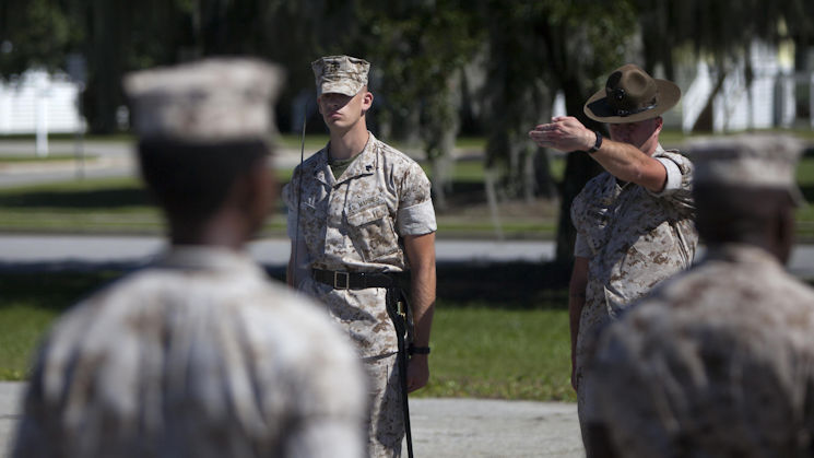 A Marine student attending drill instructor school listens to correction from his instructor while practicing drill at Marine Corps Recruit Depot Parris Island, S.C., Oct. 15, 2015. Marines who attend drill instructor school are specially selected and the school is three months long. (U.S. Marine Corps photo by Sgt. Melissa Karnath)