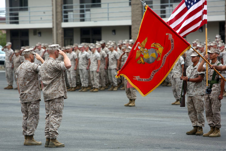 Lt. Col. Christian M. Rankin (right), commanding officer,1st Light Armored Reconnaissance Battalion, and Sgt. Maj. Steven M. Burkett (left), the battalion sergeant major, salute the national and organizational colors during the battalion's 30th anniversary rededication ceremony, aboard Marine Corps Base Camp Pendleton Calif., July 1, 2015. After the ceremony, the Marines and Sailors of the battalion hiked to a nearby beach and held the annual Highlander Games Warrior Night. (U.S. Marine Corps photo by Staff Sgt. Bobbie A. Curtis)