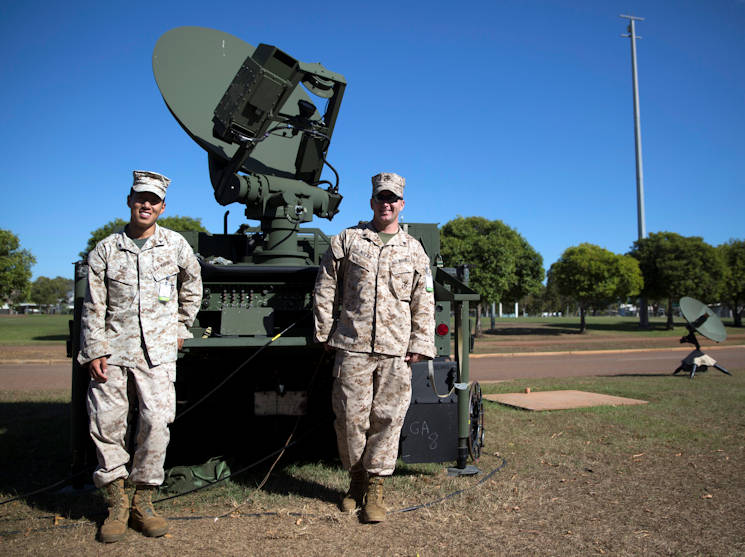 U.S. Marines, Cpl. Shea P. Nolan and Lance Cpl. Edward Y. Cho, stand in front of a Secure, Mobile, Anti-Jam, Reliable, Tactical-Terminal during exercise Talisman Sabre 2015 at Robertson Barracks, Australia, July 6, 2015. The exercise is designed to improve U.S.-Australian combat training, readiness and interoperability. Nolan, from Wallington, New Jersey, is a tropospheric scatter radio multi-channel equipment operator. Cho, from Dix Hills, New York, is a satellite communications operator and maintainer. They are with 7th Communication Battalion, III Marine Expeditionary Force Headquarters Group, III MEF, currently attached to 3rd Marine Expeditionary Brigade. (U.S. Marine Corps photo by Lance Cpl. Mandaline Hatch)