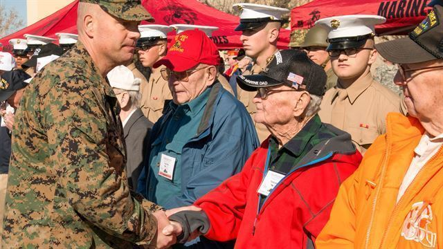 Col. Wayne Harrison, commanding officer of the Marine Artillery Detachment at Fort Sill, Okla., shakes the hands of Iwo Jima veterans at the conclusion of a ceremony held to honor them and their service on Feb. 12, 2015. The Marine Artillery Detachment performed a ceremony, provided a barbecue lunch and socialized with the Marines. (U.S. Marine Corps photo by Sgt. Melissa Karnath)