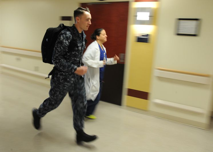 Naval Hospital Pensacola Rapid Response Team members respond to a call on January 27, 2015. Since the conversion of the Emergency Room to an Urgent Care Clinic, the Rapid Response Team has been available to respond to any medical situation in the hospital in a hurry. (U.S. Navy photo by Petty Officer 1st Class James Stenberg)