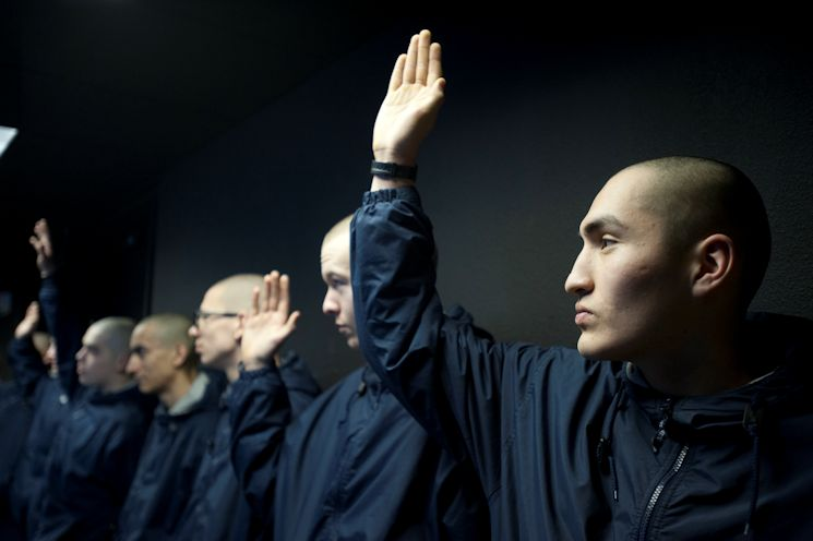 Rafael Vicens, far right, raises his hand with other cadets during a National Guard Alaska Military Youth Academy tour of the air control tower at Joint Base Elmendorf-Richardson, Alaska on February 14, 2015. Vicens volunteered for the academy after dropping out of high school. (U.S. Air Force photo by Staff Sgt. Robert Barnett)