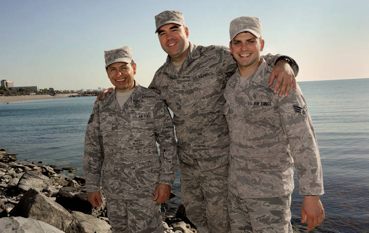 Oregon Air National Guardsmen from the 142nd Fighter Wing Civil Engineer Squadron, Tech. Sgt. Ramon Lopez, left, Senior Airman Tyler O'Bryant, center, and Senior Airman Zachariah Lewis, right, pause for a group photograph along the Black Sea in the city of Mangalia, Romania, May 13, 2015, as part of the U.S. European Command's (EUCOM) Humanitarian Civic Assistance Program (HCA). The three Airmen on deployment in Romania also recently finished a deployment in Quang Ngai province, Vietnam, during Operation Pacific Angel, a joint and combined humanitarian assistance operation led by the U.S. Pacific Air Forces. (U.S. Air National Guard photo by Tech. Sgt. John Hughel, 142nd Fighter Wing Public Affairs)