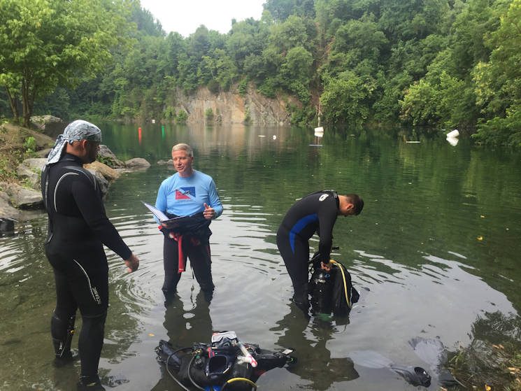 July 4, 2015 - Wounded Warrior Matthew Staton prepares for a dive with Patriot Scuba Owner Jeff Currer. Currer is the executive director of the nonprofit organization Patriots for Disabled Divers, which helps provide scuba diving lessons to wounded veterans at no cost to them. (Courtesy photo by U.S. Army & Air Force Exchange Service HQ)