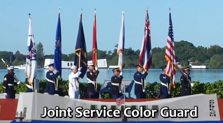 "A U.S. joint services color guard during the memorial ceremony commemorating the 73rd anniversary of the attack on Pearl Harbor on December 7, 2014. Image created by USA Patriotism! from the video ""Pearl Harbor Attack 73rd Anniversary Commemoration"""