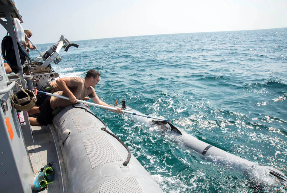 Electronic's Technician 2nd Class Alex Wade, assigned to Commander, Task Group (CTG) 56.1, recovers an unmanned underwater vehicle (UUV) during training operations using a MK 18 MOD 2 UUV on October 20, 2015. The MK 18 MOD 2 UUV uses side scan sonar to search and discover objects of interest. CTG 56.1 conducts mine countermeasures, explosive ordnance disposal, salvage-diving, and force protection operations throughout the U.S. 5th Fleet area of operations. (U.S. Navy photo by Mass Communication Specialist 3rd Class Jonah Stepanik)
