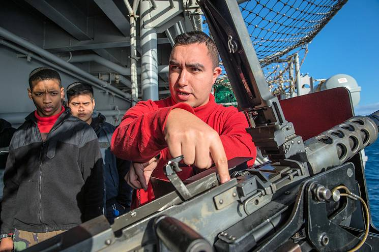 January 12, 2015 - Gunners Mate 1st Class David Jacinto, from Compton, Calif., instructs Sailors on the proper operation of a .50-caliber machine gun aboard the forward-deployed amphibious assault ship USS Bonhomme Richard (LHD 6). (U.S. Navy photo by Mass Communication Specialist 3rd Class Kevin V. Cunningham)