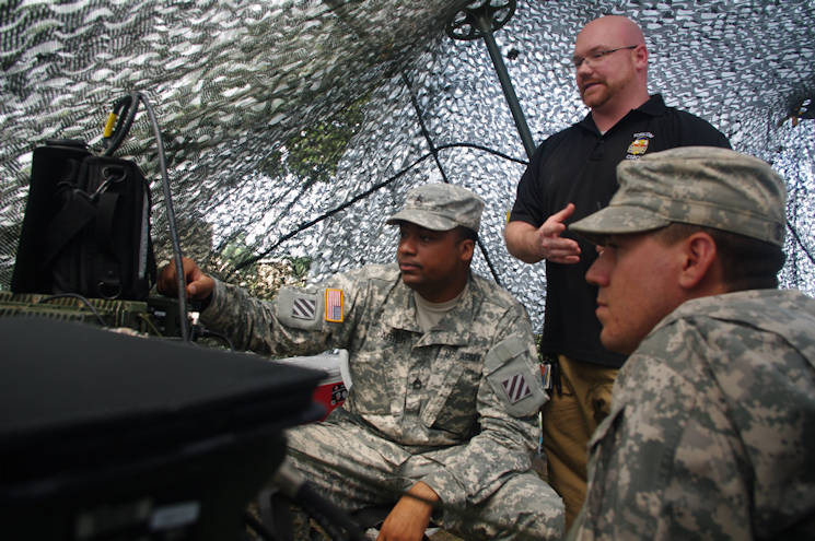 Sgt. 1st Class Willie Carter, the 3rd Infantry Division Electronic Warfare Noncommissioned Officer (left), Mr. Phillip Crandell, the 3rd Infantry Division EW Trainer (center), Sgt. Jacob Stauber, the EW NCO of 2nd Battalion, 69th Armor Regiment, 3rd Armored Brigade Combat Team, 3rd ID, observe the spectrum of frequencies being used for communications during Marne Focus on June 25, 2015. The group of EW personnel are preparing to test the reaction times of units participating in the exercise by jamming their communications. (U.S. Army photo by Staff Sgt. Aaron Knowles, 3rd ABCT, 3rd ID, PAO)