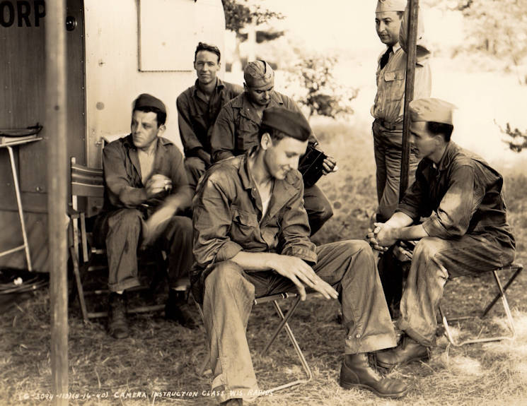 A group of soldiers take a short break while on a training exercise in Wisconsin, 1940s. (Indiana Army National Guard Air Corps photo by Sgt. Fred Mangold)