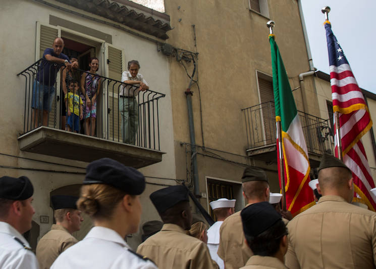 Residents of Troina, Sicily, Italy, overlook the Marines and sailors with Special-Purpose Marine Air-Ground Task Force Crisis Response-Africa, Detachment A, as they parade through the streets alongside Italian veterans during the Battle of Troina remembrance ceremony August 2, 2015. Representatives of the Sicilian community, civil and military, participated side-by-side with their American counterparts honored the sacrifices made during the battle in 1943. (U.S. Marine Corps photo by Cpl. Olivia McDonald)