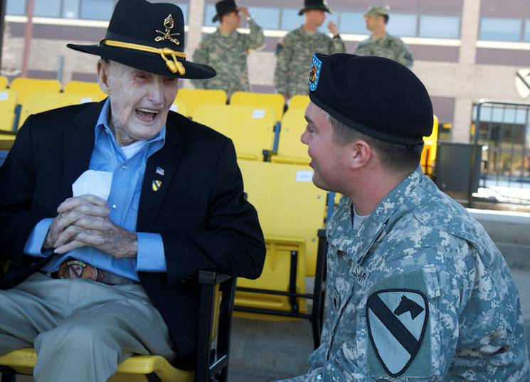 "Sgt. Clinton Woodley, a 96-year-old WWII veteran laughs with Spc. Nathan Melton, a Soldier assigned to the 1st Cavalry Division before an awards ceremony for Woodley at Cooper Field, at Fort Hood, Texas, March 27, 2015. Melton, who knows Woodley from his hometown, said he heard about the ceremony and ""had to be there."" Woodley served in the 1st Cav. Div. before WWII and in the Pacific Theater of Operations. Woodley was presented the Bronze Star Medal; the Philippine Liberation Medal; the Asiatic-Pacific Medal with four bronze campaign service stars; and the World War II Victory Medal. (U.S Army photo by Sgt. Angel Turner, 1st Cav. Div. PA)"