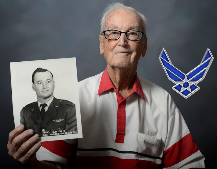 Retired Lt. Col. Clifton Ward, a World War II and Vietnam War combat pilot, shows his official photo, taken May 19, 1955, during a visit to MacDill Air Force Base, Fla., Nov. 5, 2015. During his flying career, Ward piloted 29 aircraft, was reported missing in action, and earned the Distinguished Flying Cross, the Bronze Star and the Air Medal for his actions in WWII and Vietnam. (U.S. Air Force photo by Tech. Sgt. Brandon Shapiro with Air Force logo added by USA Patriotism!)