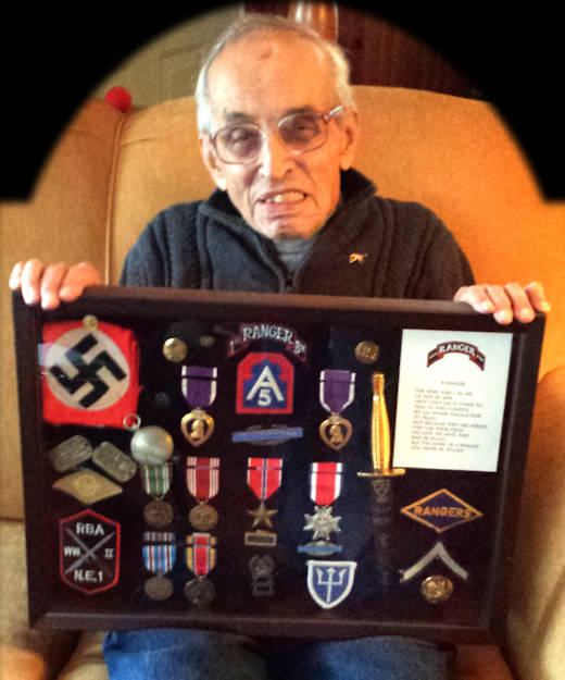 August 13, 2015 - World War II Army veteran James Palmer (91) shows some of his wartime memorabilia. (U.S. Army photo by Master Sgt. Timothy Lawn)