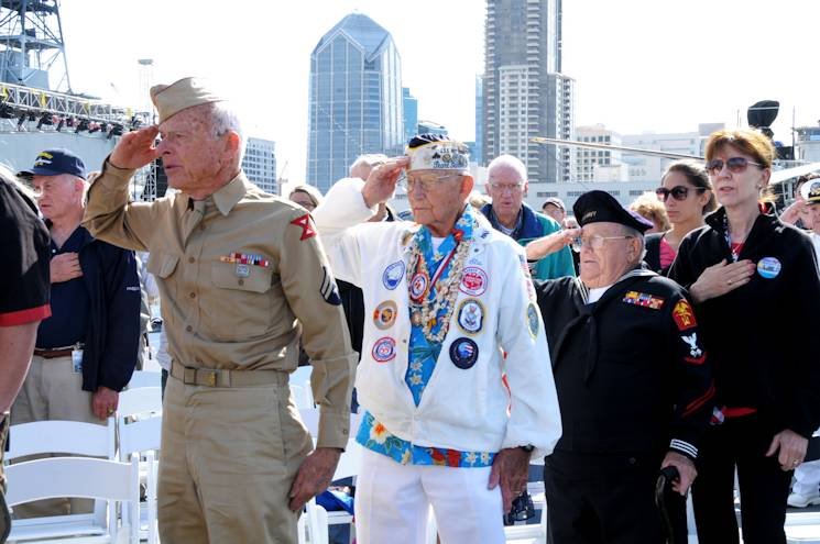May 23, 2015 - World War II veterans render a hand salute during the parading of the colors to kick off Legacy Week and Memorial Day weekend during a wreath ceremony held aboard the USS Midway Museum. This year's Legacy Week is dedicated to the 200,000 Sailors who called the USS Midway (CV-41) home and the more than 300,000 lives lost in World War II. (U.S. Navy photo by Mass Communication Specialist 3rd Class Nolan Kahn)