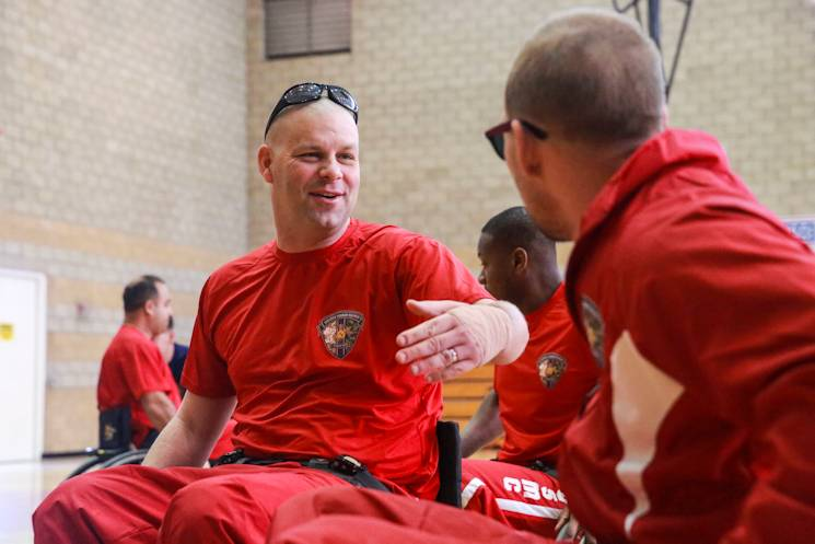 March 3, 2015 - Sgt. Jeremy Anderson, from Birmingham, Alabama, encourages his teammate at a wheelchair basketball practice during the 2015 Marine Corps Trials Competition provides opportunities for the Marines to train as athletes, while increasing their strength so they can continue their military service or develop healthy habits for life outside the service. The Marine Corps Wounded Warrior Regiment enables wounded, ill, or injured Marines to focus on their abilities and to find new avenues to thrive. The fifth annual Marine Corps Trials was held at Marine Corps Base Camp Pendleton, Calif., March 3-11, 2015. Athletes competed in archery, cycling, shooting, swimming, track, field, sitting volleyball, and wheelchair basketball. (U.S. Marine Corps photo by Cpl. Jared Lingafelt)