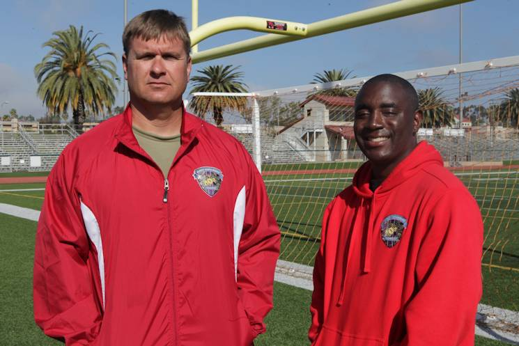 March 10, 2015 - Gunnery Sgt. Gabriel Guest, a single leg amputee (Left), and Sgt. Michael Pride, an assistant coach for track (right), reunite after seven years at the 2015 Marine Corps Trials aboard Marine Corps Base Camp Pendleton, CA. (U.S. Marine Corps photo by Sgt. Brady Wood)