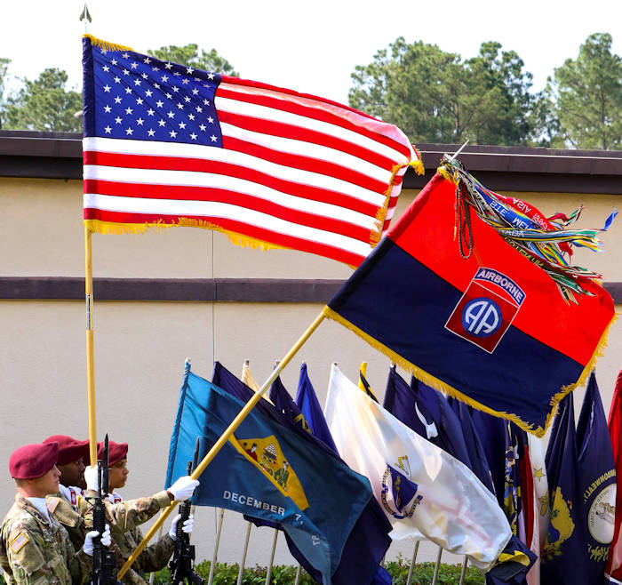 May 25, 2016 - The 82nd Airborne Division Sustainment Brigade color guard salutes for the National Anthem during a memorial ceremony to unveil a new monument dedicated to the Paratroopers who lost their lives while conducting combat training at the 82nd Abn. Div. War Memorial Museum on Fort Bragg, NC. Families, friends, and veteran Paratroopers paid their respects and honored their fallen comrades. The new monument featured more than 220 names, all training casualties. (U.S. Army photo by Sgt. Anthony Hewitt)