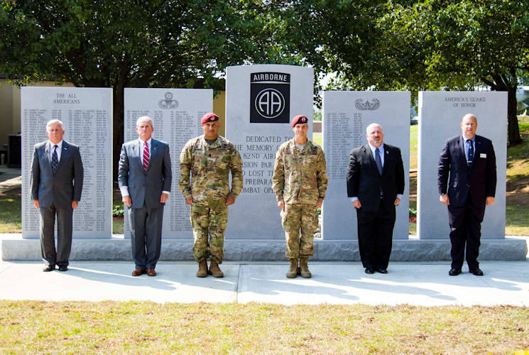 May 25, 2016 - Maj. Gen. Richard Clarke and Command Sgt. Maj. Michael Green, 82nd Airborne Division commanding general and command sergeant major, and 82nd Abn. Div. Association leaders unveil a new monument dedicated to the Paratroopers who lost their lives while conducting combat training during a memorial ceremony at the 82nd Abn. Div. War Memorial Museum on Fort Bragg, NC. Families, friends, and veteran Paratroopers paid their respects and honored their fallen comrades. The new monument featured more than 220 names, all training casualties. (U.S. Army photo by Sgt. Daniel Schroeder)