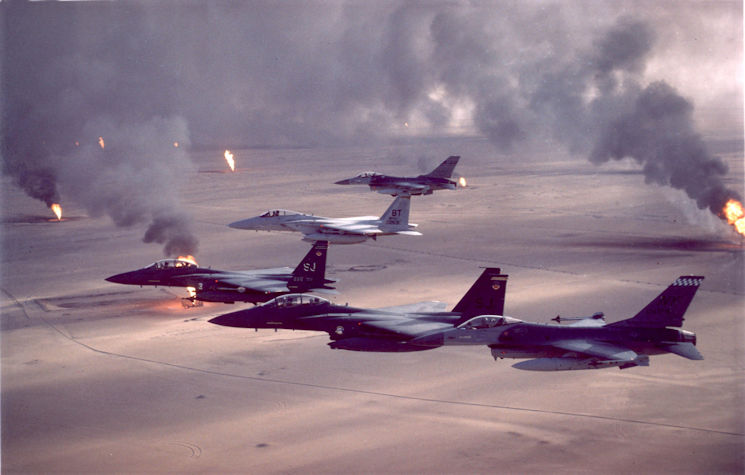 U.S. Air Force F-16A Fighting Falcon, F-15C Eagle and F-15E Strike Eagle fighter aircraft fly over burning oil field sites in Kuwait during Operation Desert Storm. (U.S. Air Force archive photo)