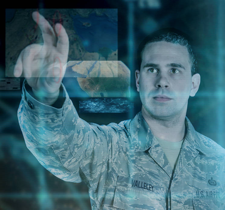 Graphic representation of Tech. Sgt. Jason Valleley, 204th intelligence analyst, as he simulates manipulating data in Google Earth. Valleley headed the development for a way to use classified Google Earth with integrated intelligence gathered from multiple sources to aid United States' military units throughout the world. The images employed in this illustration are purely representational and do not reflect any current or past intelligence operations. (U.S. Air National Guard illustration by Senior Airman Kellyann Novak)