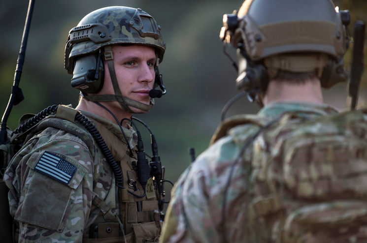 Senior Airman Tormod Lillekroken, 2nd Air Support Operations Squadron joint terminal attack controller, talks to a fellow JTAC as part of a training scenario during Exercise Serpentex '16 in Corsica, France, March 15, 2016. Lillekroken is one of four American JTACs participating in the French-led NATO exercise with 11 other nations. (U.S. Air Force photo by Staff Sgt. Sara Keller)
